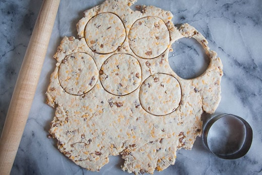 Roll out the dough and cut out the biscuits with a 3-inch round cutter.