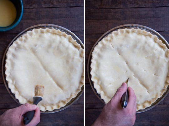 Brush the top of the crust with egg wash then cut vents in it.