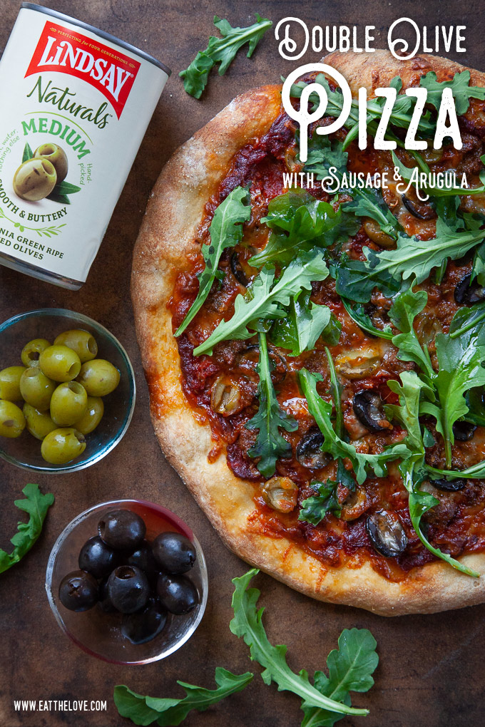 Double Olive Pizza with Sausage and Arugula.