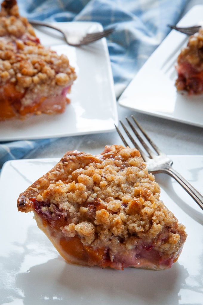 Summer Fruit Pie with Crumb Topping is packed full with summer stone fruit like plums, pluots, nectarines, peaches and cherries.