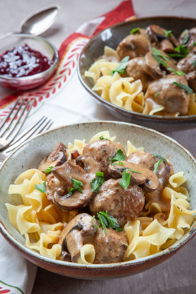 Swedish Meatball Stroganoff, a mashup of Swedish Meatballs and Beef Stroganoff, served in bowls.