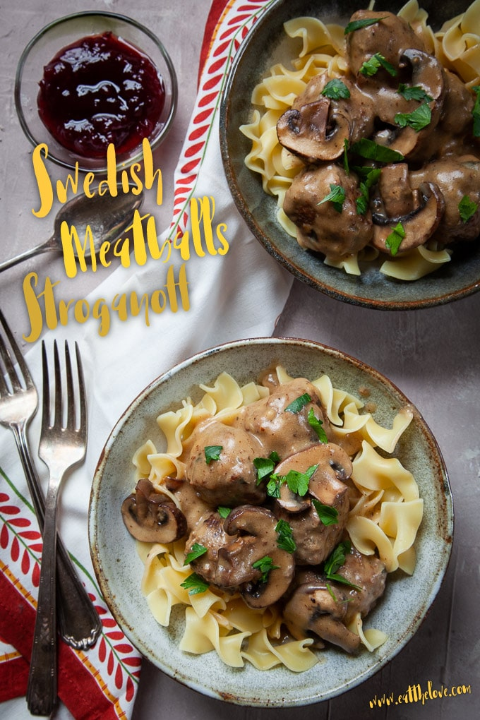 Swedish Meatball Stroganoff served in two bowls with side bowl of lingonberry sauce.