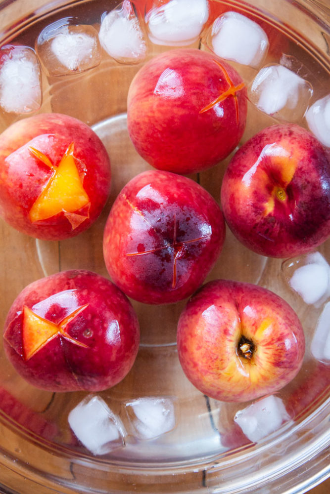 Dunk the peaches in ice cold water to shock them. Then peel!