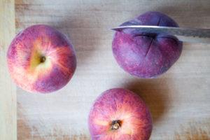 cut an x on the bottom of the peach