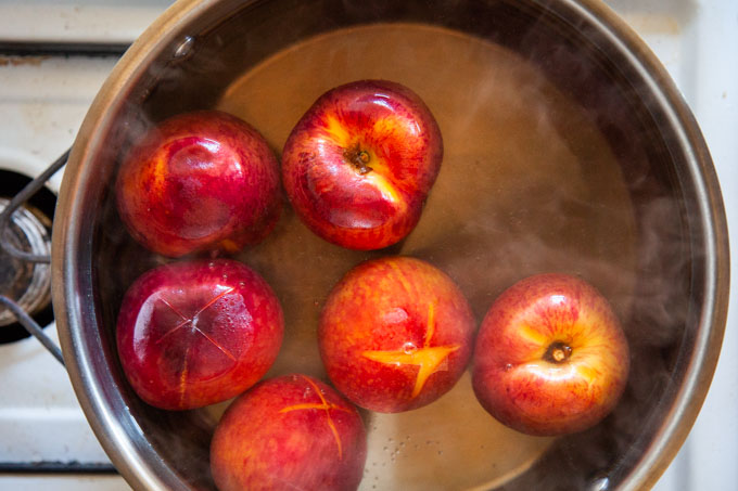 quickly cook the peaches in the hot water