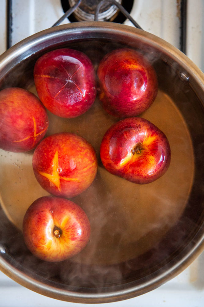 Quickly blanch the peaches in boiling water then peel!