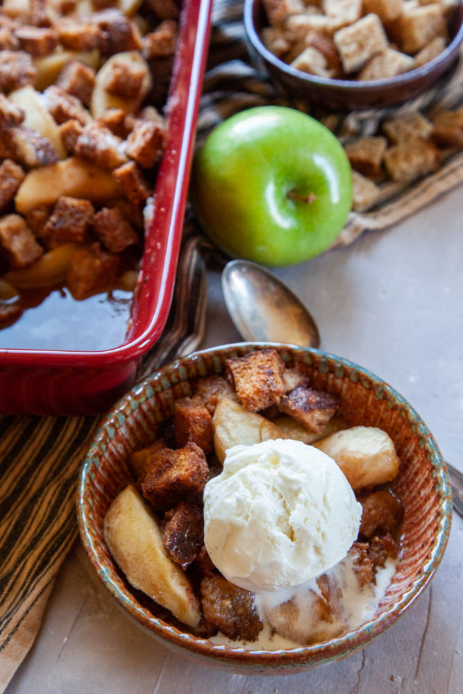 Simple Apple Brown Betty Recipe made with IPA beer, served with a scoop of vanilla bean ice cream.