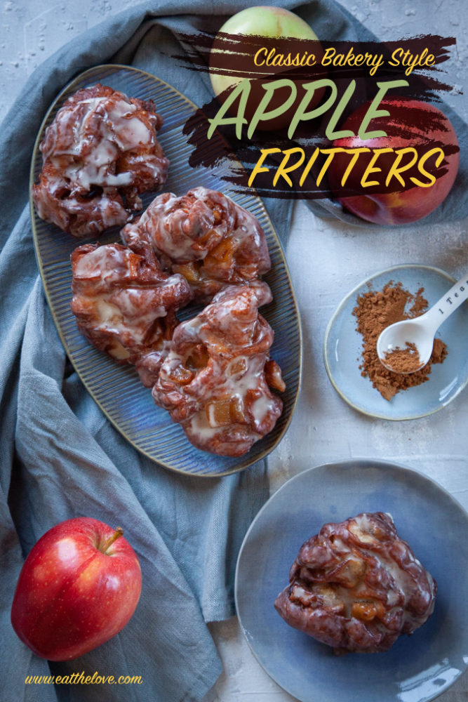 Homemade Apple Fritters on a plate, next to apples and a small dish with cinnamon.