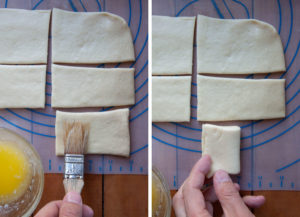 Brush half of one of the small rectangles with butter. Then fold it over.