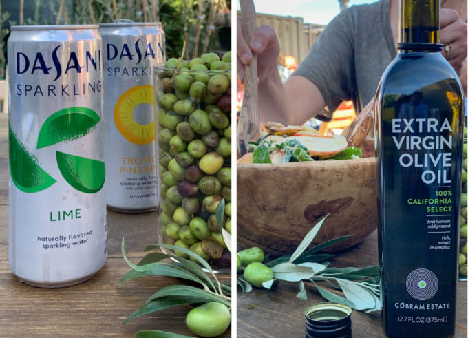 Cans of Dasani Sparkling Water and a bottle of Cobram Estate Extra Virgin California Select Olive Oil.
