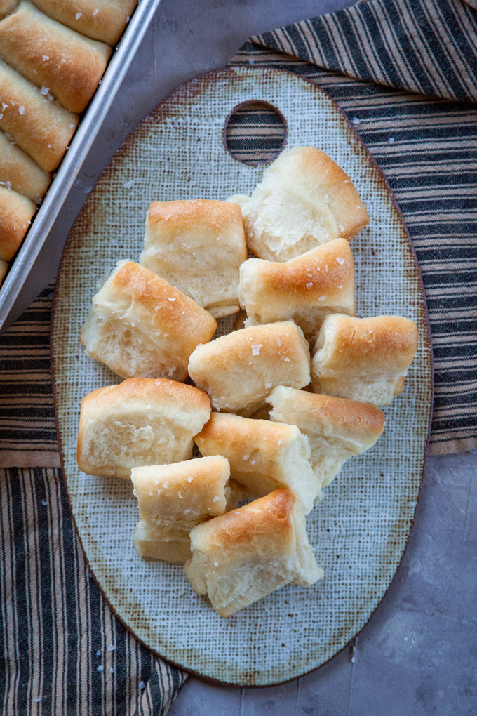 Parker House Rolls on a serving plate.