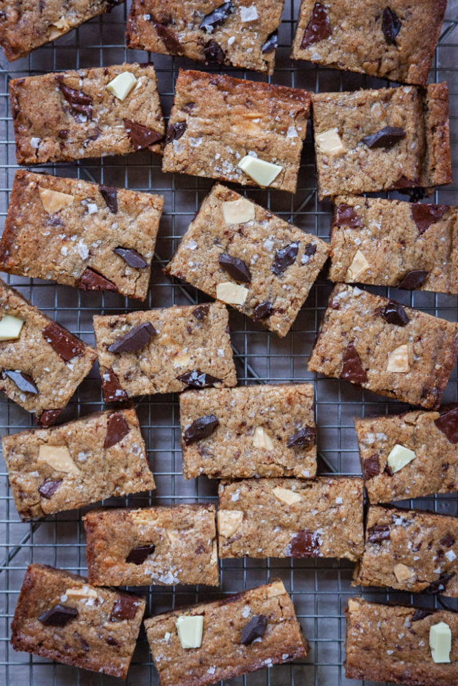 Blondie Bars, otherwise known as chocolate chunk cookie bars, on a wire rack