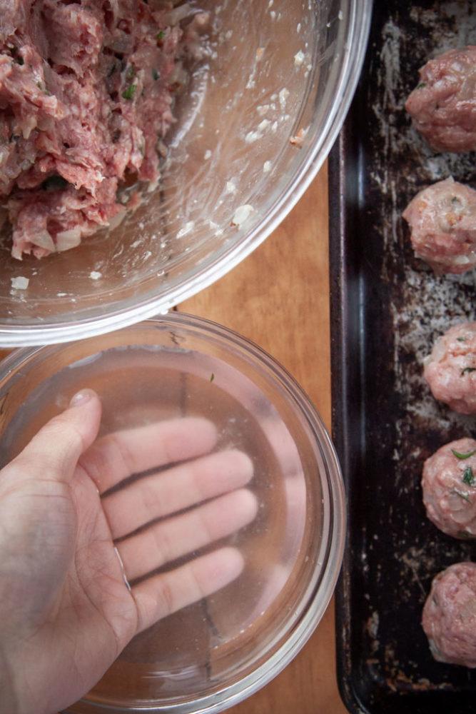 dampen your hands to help form the Irish lamb meatballs.