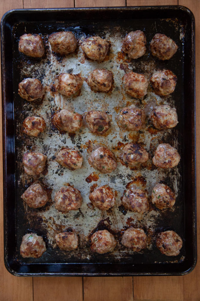 Bake the meatballs on a rimmed baking sheet to make sure they are fully cooked.