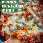 Easy baked ziti in a saute pan with a spoon scooping out some.