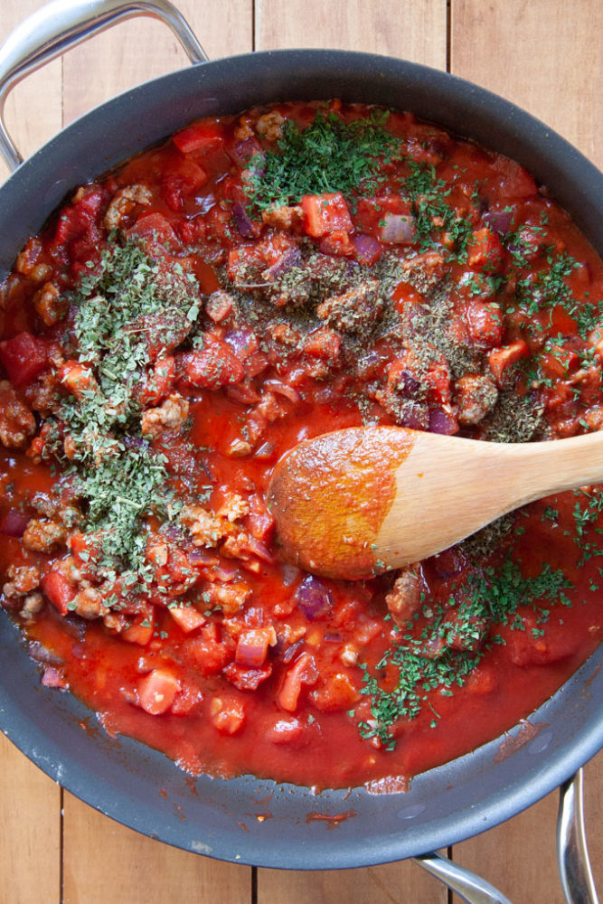 Dry fragrant Italian spices sprinkled over a tomato sauce.