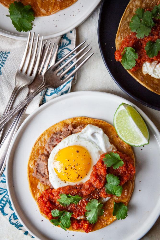Huevos Rancheros (rancher egg tacos) on plates.