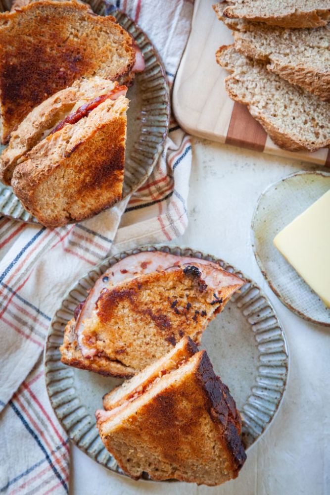 Ham and Cheese Toastie Sandwiches on plates.