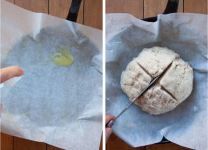 Spray parchment paper with oil, then place the dough ball on the paper and cut a cross on top of it.