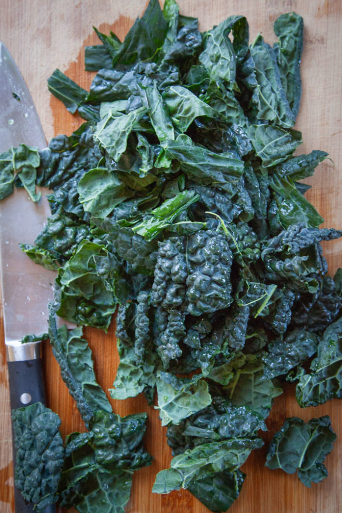 Chopped kale on a cutting board.
