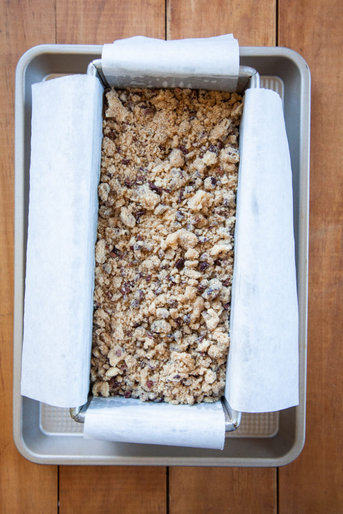 Unbaked sourdough banana bread with crumb topping ready to be placed in oven.