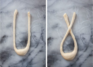 Make a U shape with the dough and then cross the legs over once.