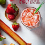a glass of strawberry rhubarb soda made with homemade syrup surrounded by strawberries, rhubarbs, ginger and lime.