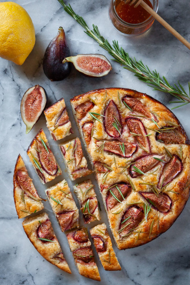 Fig focaccia cut on a marble surface.