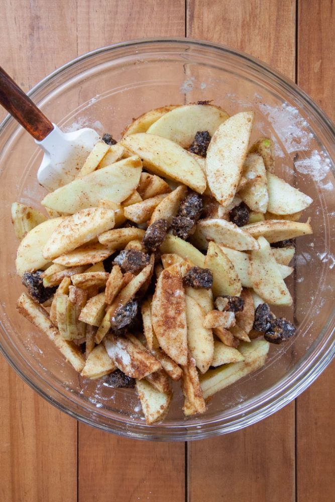 All the apple and prune filling ingredients combined in a bowl