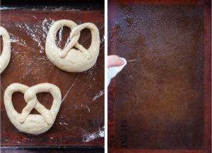 Left image is unbaked pretzels covered with plastic wrap. Right image is a silicon baking mat on a baking sheet being sprayed with cooking oil.