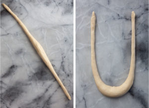 Left image is a rope of pretzel dough on a marble surface. Right image is the rope of dough formed in the shape of a U.