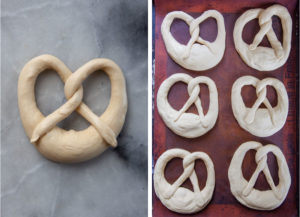 Left image is an unbaked pretzel already formed on a marble surface. Right image is 6 of the unbaked pretzels on a baking sheet lined with a silicon baking mat.