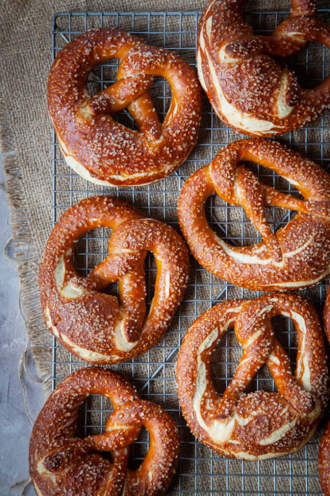 Traditional Bavarian pretzels on a wire rack.