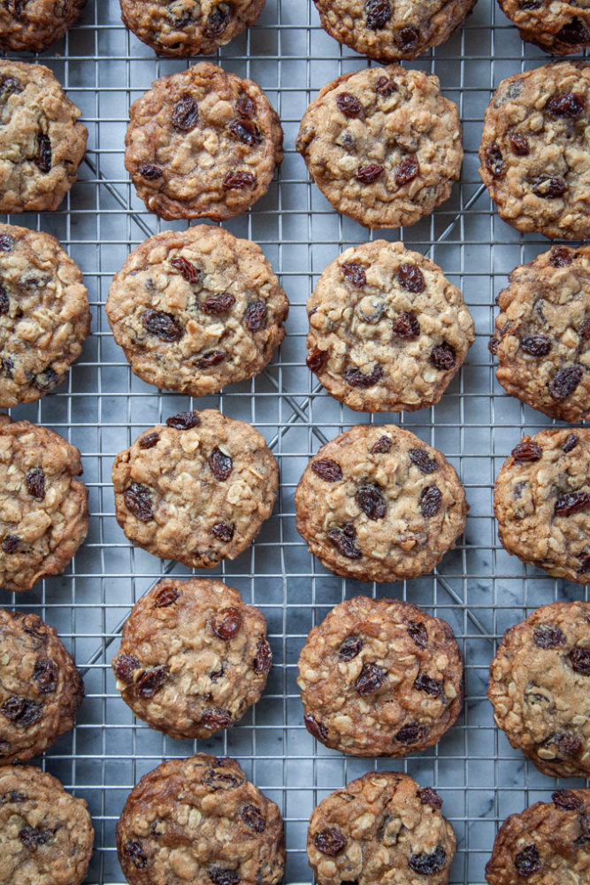 Oatmeal raisin cookies on a wire cooling rack.