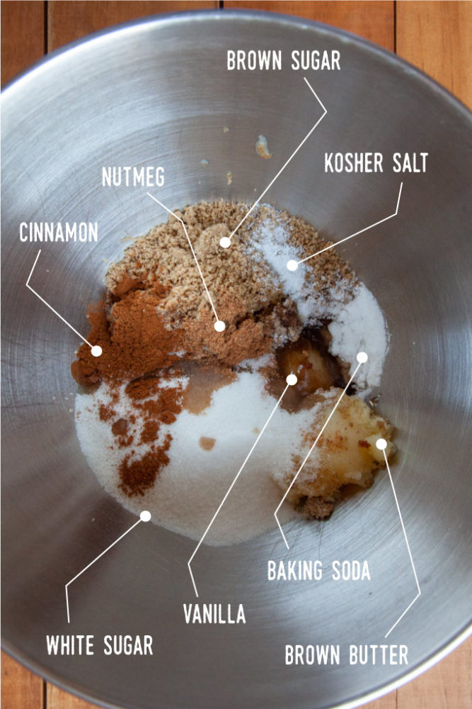 Brown butter with the brown sugar, white sugar, cinnamon, nutmeg, vanilla extract, salt and baking soda all in a metal bow.
