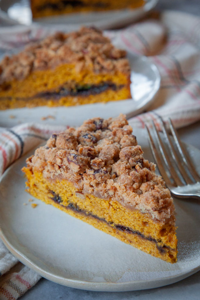Slices of pumpkin coffee cake on a plates.